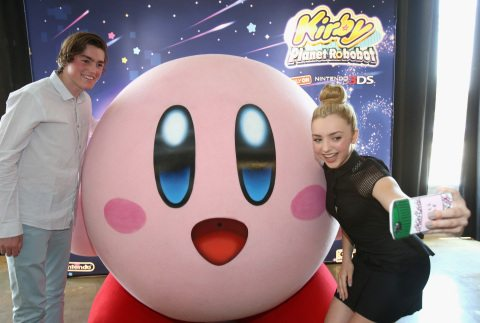 "CULVER CITY, CA - JUNE 22:  In this photo provided by Nintendo of America, Peyton List from Disney's ""Bunk'd' who is starring in the upcoming feature ""The Thinning"" and Spencer List from ""The Bachelors"" interact with Kirby at the Kirby: Planet Robobot celebration at Smashbox Studios in Culver City, California, on June 22, 2016. Kirby: Planet Robobot, the latest instalment in the popular franchise, available now for the Nintendo 3DS family of systems.  (Photo by Jonathan Leibson/Getty Images for Nintendo of America) *** Local Caption *** Peyton List;Spencer List"