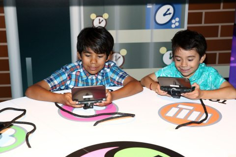 HOLLYWOOD, CA - SEPTEMBER 08:  Kids check out Yo-Kai Watch 2 for Ninendo 3DS at Siren Studios on September 8, 2016 in Hollywood, California.  (Photo by Joe Scarnici/Getty Images for Nintendo)